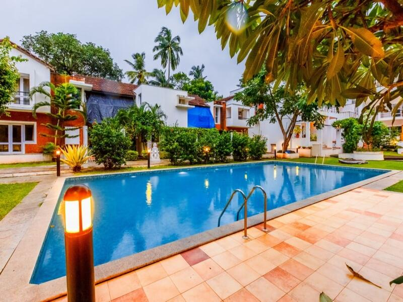 evening  look of pool in holiday villa close to candolim beach